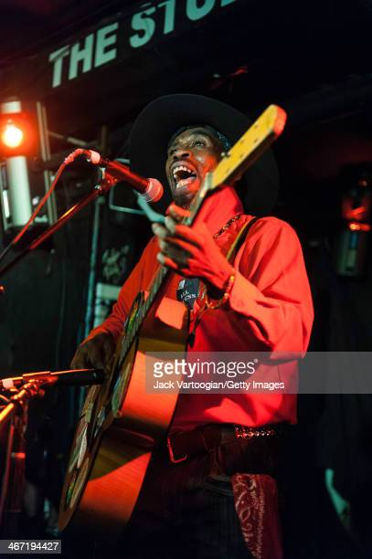 Jamaican musician Brushy One-String performs on his one-string guitar at Webster Hall's Studio Room Stage during GlobalFest 11, New York, New York,...