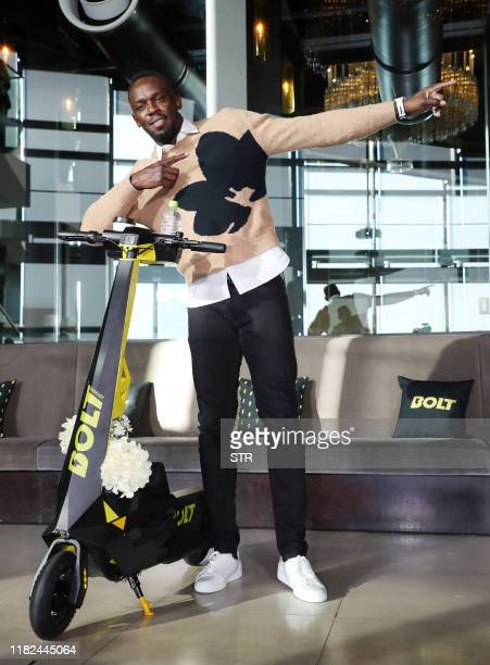Jamaican Olympic sprinter Usain Bolt poses with a personal electric scooter from his new company Bolt Mobility in Tokyo on November 15 2019 / Japan...