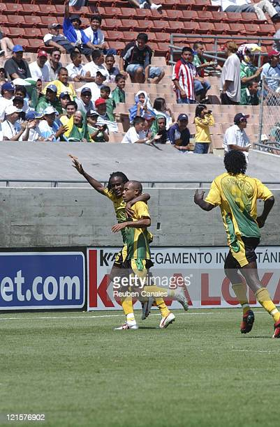 Jamaican players celebrate a goal in the CONCACAF First Round of Group A Gold Cup soccer match 12 with Jamaica and South Africa playing to 3 to 3...