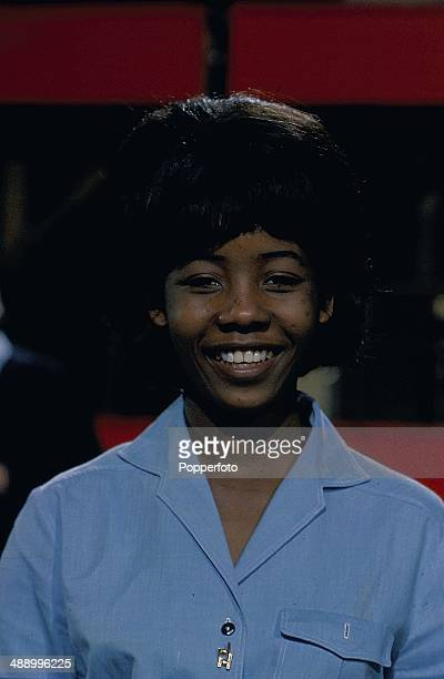 1968 Jamaican pop singer Millie Small poses on the set of the television series 'Ready Steady Go' in 1968
