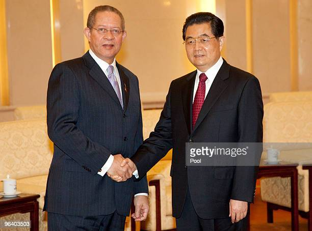Jamaican Prime Minister Bruce Golding meets with Chinese President Hu Jintao at the Great Hall of the People February 4 2010 in Beijing China Golding...
