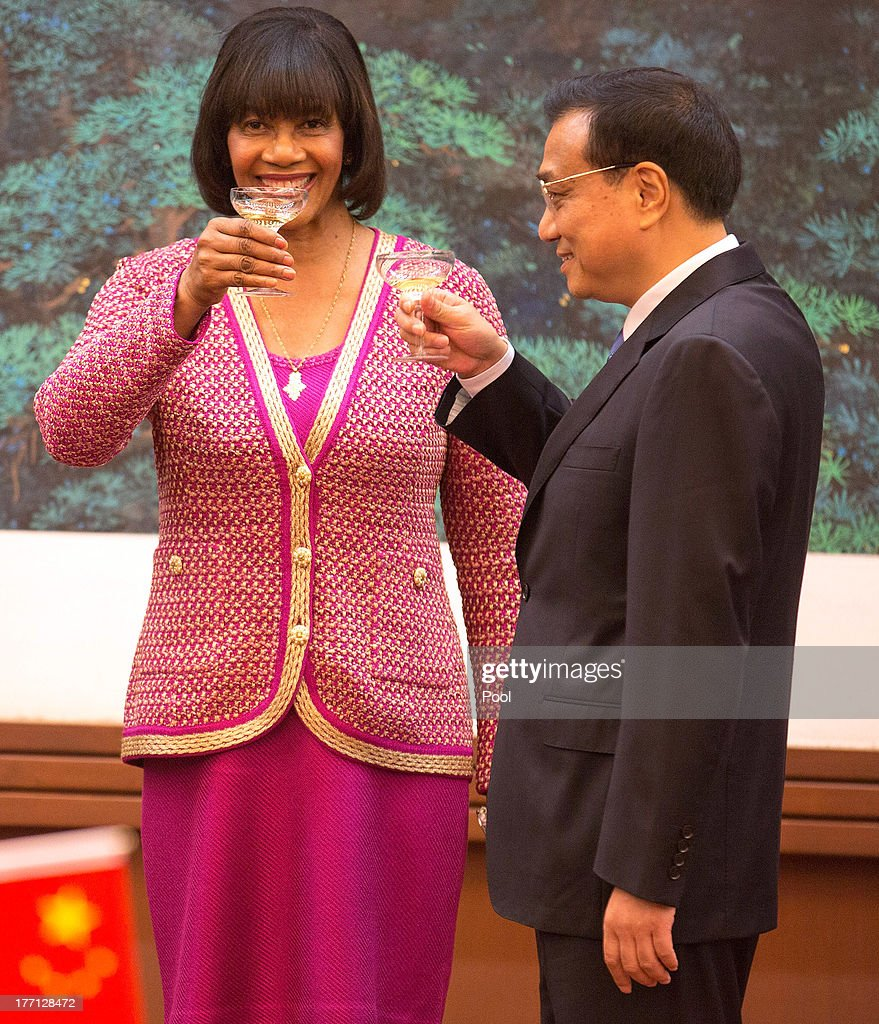 Jamaican Prime Minister Portia Simpson Miller (L) and Chinese Premier Li Keqiang (R) attend a signing ceremony at the Great Hall of the People, on August 21, 2013 in Beijing, China. Simpson Miller is on a five day visit to China to bolster economic and diplomatic ties.