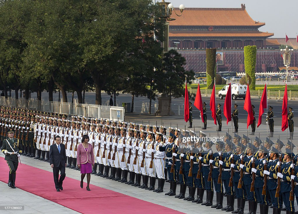 Jamaican Prime Minister Portia Simpson Miller and Chinese Premier Li Keqiang attend a welcoming ceremony at the Great Hall of the People, on August 21, 2013 in Beijing, China. Simpson Miller is on a five day visit to China to bolster economic and diplomatic ties.