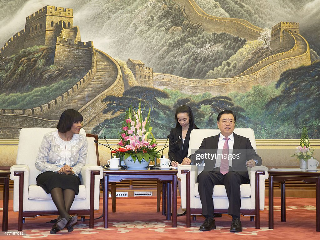 Jamaican Prime Minister Portia Simpson Miller (L) and Chinese Vice Premier Zhang Dejiang attend talks at the Great Hall of the People, on August 22, 2013 in Beijing, China. Simpson Miller is on a five day visit to China to bolster economic and diplomatic ties.