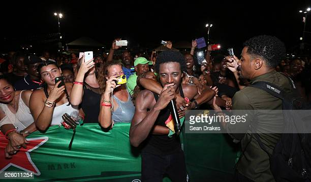 Jamaican recording artist Romain Virgo is mobbed by fans during the One Love Reggae Concert in the Festival Village as part of the 47th annual...
