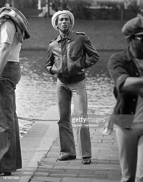 Jamaican reggae musician Bob Marley posed by the canal in Amsterdam Netherlands in 1976