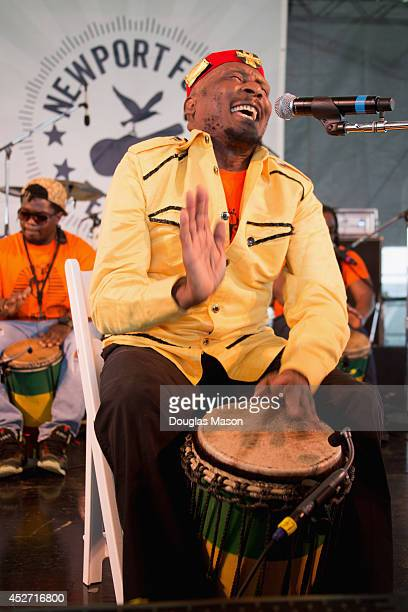 Jamaican reggae musician Jimmy Cliff performs during the 2014 Newport Folk Festival at Fort Adams State Park on July 25 2014 in Newport Rhode Island
