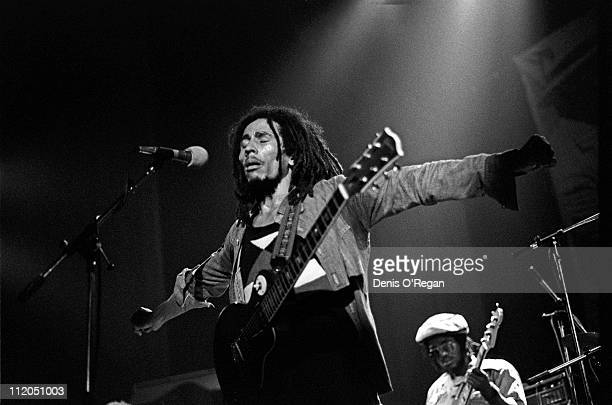 Jamaican reggae singer Bob Marley performing on stage at the Hammersmith Odeon, London, 1976.