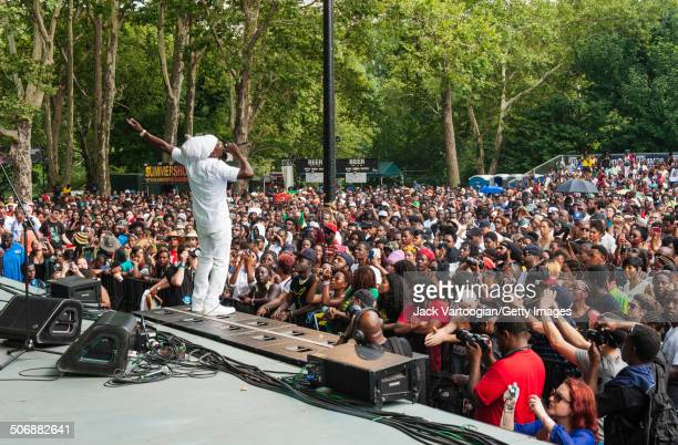Jamaican Reggae singer Junior Reid performs with the Statement Band at an afternoon of Reggae music at Central Park SummerStage New York New York...