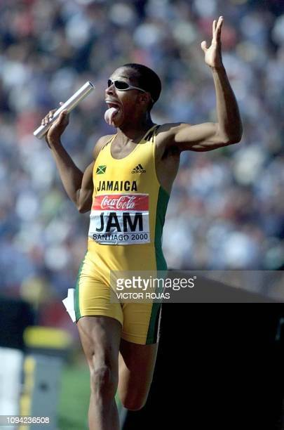 Jamaican runner Brandon Simpson crosses the finish line to lead her team to victory in the 4x400 men race marking the best time of the year 2000 3606...