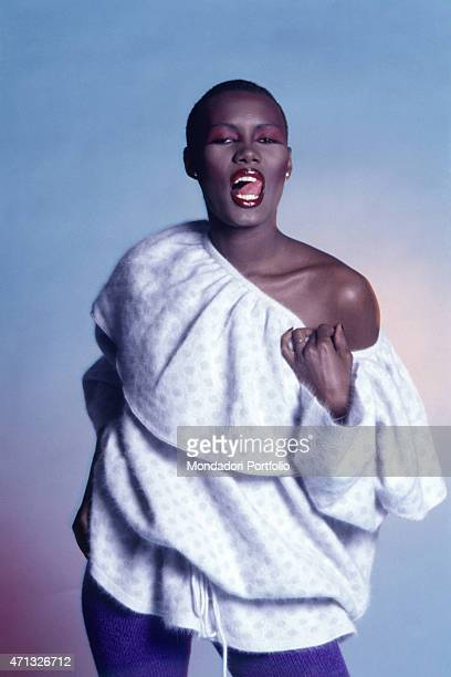 Jamaican singer and actress Grace Jones posing pulling out her tongue 1987