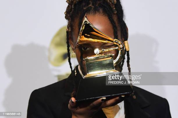 Jamaican singer Koffee poses with the award for Best Reggae Album for Rapture in the press room during the 62nd Annual Grammy Awards on January 26 in...