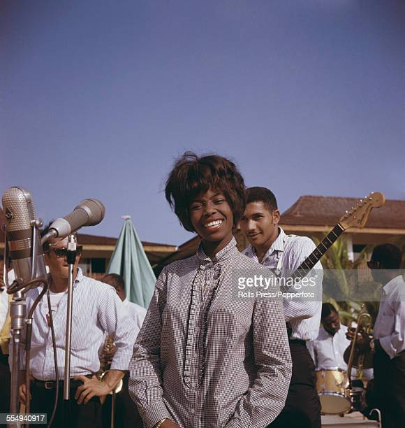 Jamaican singer Millie Small who had an international hit with the song 'My Boy Lollipop' pictured with her backing band during a tour of Jamaica...