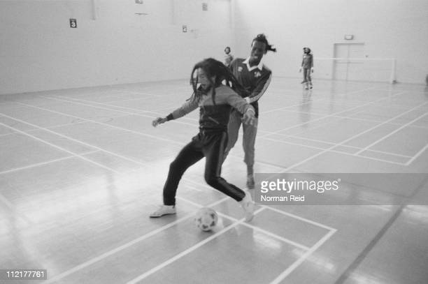 Jamaican singersongwriter Bob Marley being challenged by Jamaican musician Trevor Bow during a football match between a team led by Marley and...