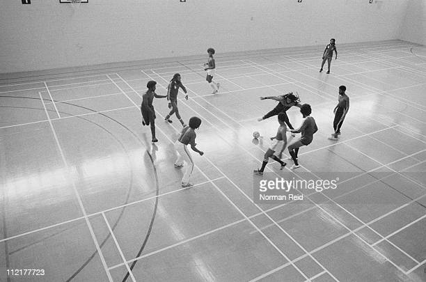 Jamaican singer-songwriter Bob Marley with the ball during an amateur football match against a team led by fellow reggae artist Eddy Grant ,...