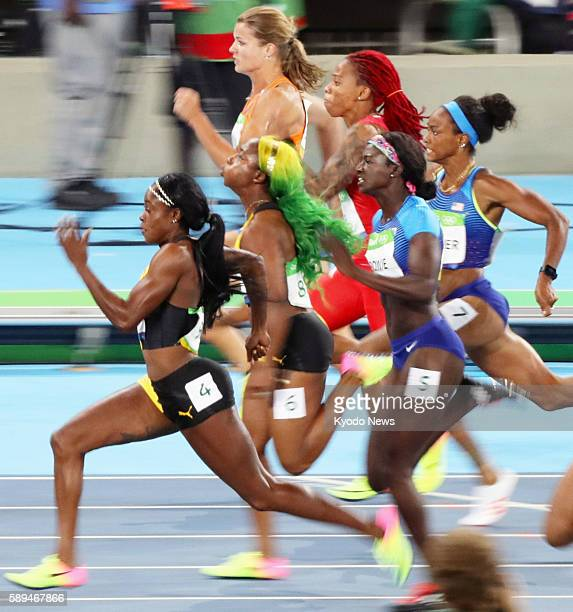 Jamaican sprinter Elaine Thompson leads the other finalists on her way to winning the women's 100-meter gold medal in the athletics competition of...