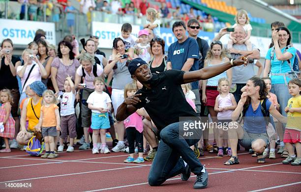 Jamaican sprinter Usain Bolt poses during a promotional event with children on May 23 2012 prior to the Zlata Tretra athletics meeting in the eastern...