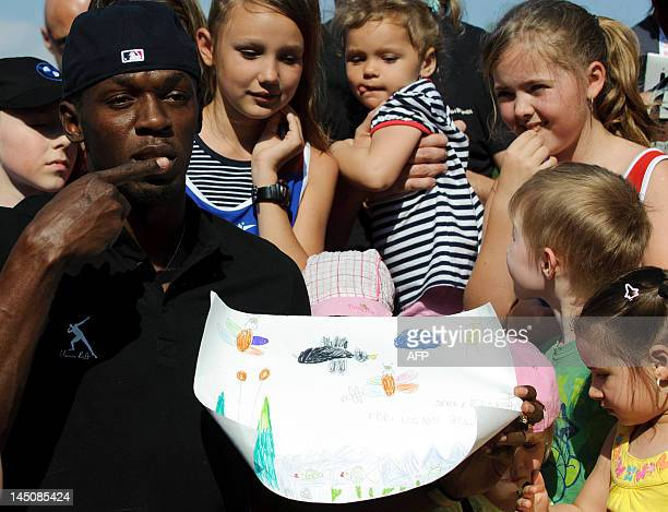 Jamaican Sprinter Usain Bolt poses on May 23 2012 during a promotional event with children prior to the Zlata Tretra athletics meeting in the eastern...