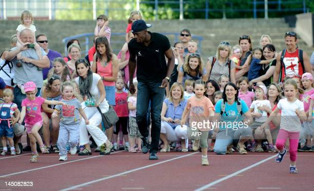 Jamaican sprinter Usain Bolt takes takes part in a promotional event with children on May 23 2012 prior to the Zlata Tretra athletics meeting in the...