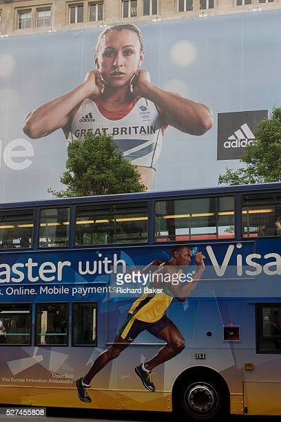 Jamaican sprinter Usain Bolt's Visa ad on a red London bus and a inspiring image of Team GB gold medallist heptathlete Jessica Ennis on the exterior...
