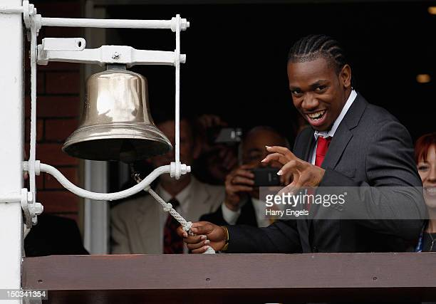 Jamaican sprinter Yohan Blake poses for photographers before ringing the bell at the start of play during day one of the 3rd Investec Test match...