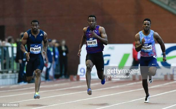 Jamaican sprinters Yohan Blake Julian Forte and US sprinter Isiah Young compete in the men's 100 metres event during the AG Insurance Memorial Van...