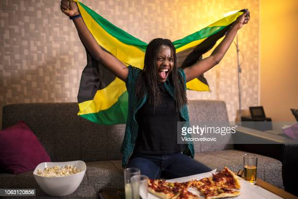 Jamaican supporter watch sport on the tv