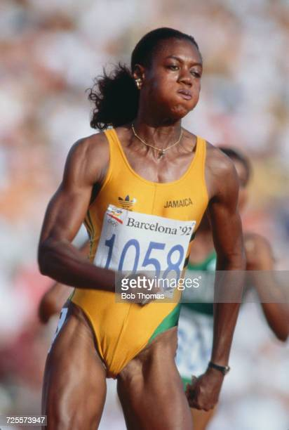 Jamaican track athlete Merlene Ottey pictured in action during competition to finish in third place to win the bronze medal in the Women's 200 metres...
