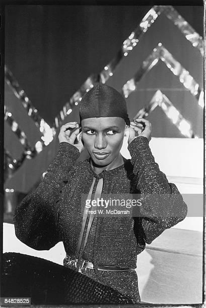 JamaicanAmerican model actress and singer Grace Jones adjusts a closefitting cap while at the nightclub Studio 54 New York New York December 29 1977