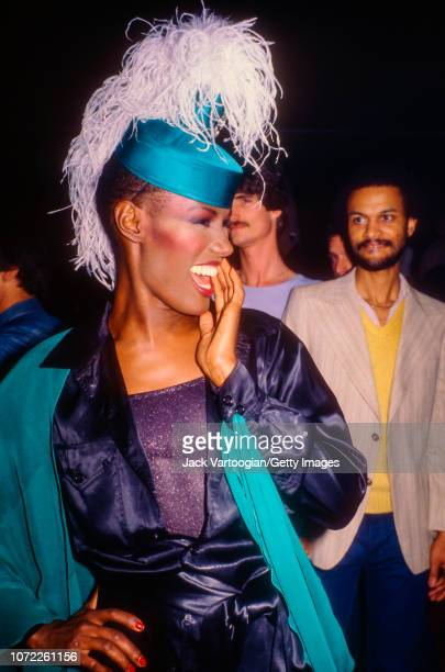 JamaicanAmerican music model and actress Grace Jones poses for fans at the Electric Circus mightclub New York New York April 25 1979