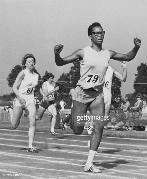 Jamaican-born British runner Marilyn Neufville raises her arms in victory ahead of South African-born British runner Lillian Board , British runner...