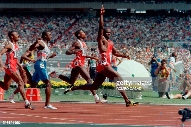 Jamaicanborn Canadian Ben Johnson crosses the finish line to win the Olympic 100m final in a world record 979 seconds on September 24 1988 at Seoul...