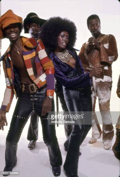 Jamaicanborn model Grace Jones and members of American Funk RB and Rock group the Chambers Brothers pose in front of white background New York 1972