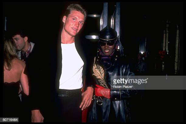 Jamaicanborn singer actor model Grace Jones and Swedishborn actor Dolph Lundgren 1983