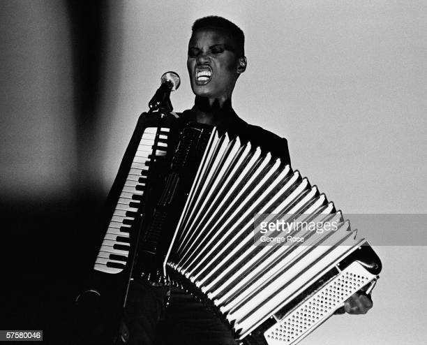 Jamaicanborn singer fashion model and actress Grace Jones performs onstage during a 1981 concert at the Savoy Club in New York The androgynous Jones...