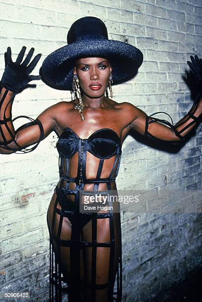 Jamaicanborn singer Grace Jones wearing a cutaway dress and black straw hat 1989