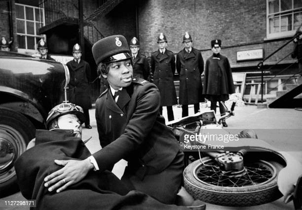 Jamaican-born Sislin Fay Allen becomes the first black woman to join London's Metropolitan Police Force, 15th February 1968. Here she is learning how...