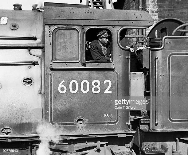 The fireman of class A3 4-6-2 No 60082 Neil Gow waits for right of way to return to the top shed at King's Cross Station, London. Photograph by Colin...