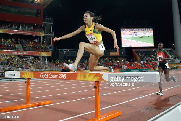 Jamaica's Aisha Praught clears a barrier ahead of Kenya's Celliphine Chepteek Chespol in the athletics women's 3000m steeplechase final during the...