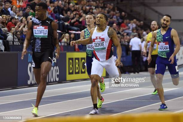 Jamaica's Akeem Bloomfield croses the line to finish in first place ahead of US Obi Igbokwe an d third placed Kuwait's Yousef Karam during the men's...