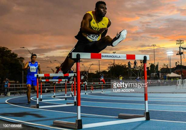 TOPSHOT Jamaica's Annsert Whyte takes part in the men's 400 meters hurdles semifinal race during the 2018 Central American and Caribbean Games in...