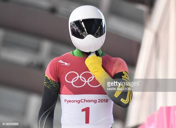 Jamaica's Anthony Watson adjusts his helmet at the end of the mens's skeleton heat 1 during the Pyeongchang 2018 Winter Olympic Games at the Olympic...