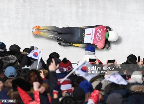 Jamaica's Anthony Watson competes in the mens's skeleton heat 3 run during the Pyeongchang 2018 Winter Olympic Games at the Olympic Sliding Centre on...