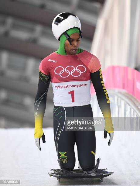 Jamaica's Anthony Watson looks on after finishing in the mens's skeleton heat 1 during the Pyeongchang 2018 Winter Olympic Games at the Olympic...