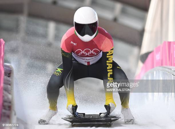 Jamaica's Anthony Watson slows down at the end of the mens's skeleton heat 2 during the Pyeongchang 2018 Winter Olympic Games at the Olympic Sliding...