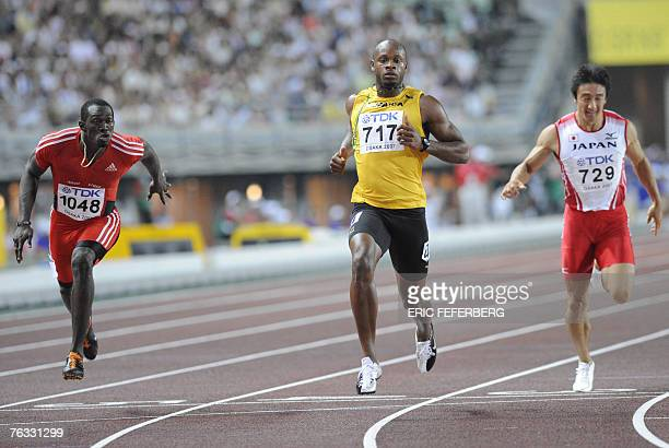 Jamaica's Asafa Powell crosses the finish line ahead of Trinidad and Tobago's Marc Burns and Japan's Nobuharu Asahara during the mens 100m semi...