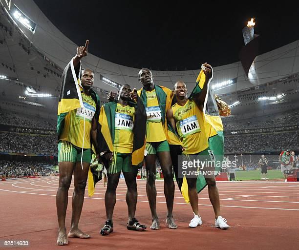 Jamaica's Asafa Powell Nesta Carter Usain Bolt and Michael Frater celebrate after winning the men's 4100m relay final at the 'Bird's Nest' National...