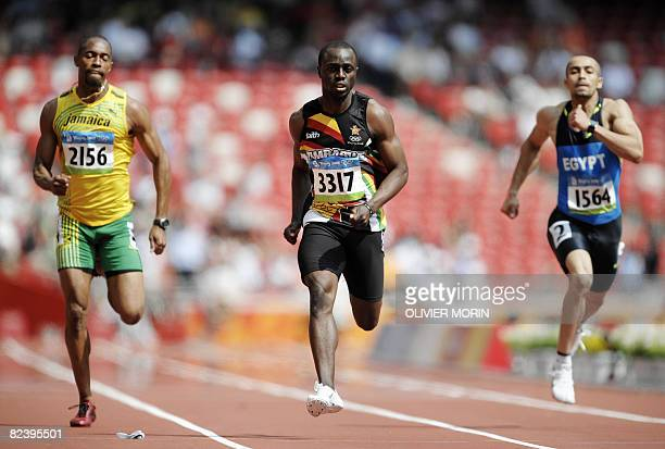 Jamaica's Christopher Williams Zimbabwe's Brian Dzingai and Egypt's Amr Seoud compete in the men's first round 200m heat 2 at the Bird's Nest...
