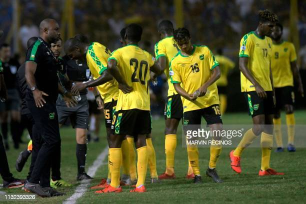 Jamaica's coach Theodore Whitmore speaks with his players during the CONCACAF League of Nations football match between El Salvador and Jamaica on the...