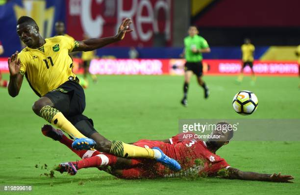 Jamaica's Cory Burke is stopped by Canada's Manjrekar James during their 2017 CONCACAF Gold Cup match at the University of Phoenix Stadium on July...
